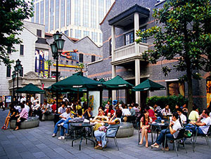 Shanghai, China: upscale Xintiandi (New Heaven and Earth) Restaurant Mall with customers of Starbucks Coffee.